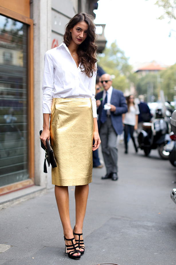 Highlight metallic pieces with a classic button-up skirt and shoes.