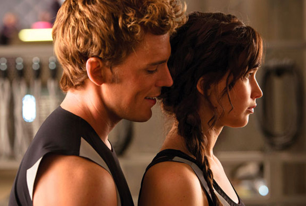 Finnick Odair (Sam Claflin) and Katniss.