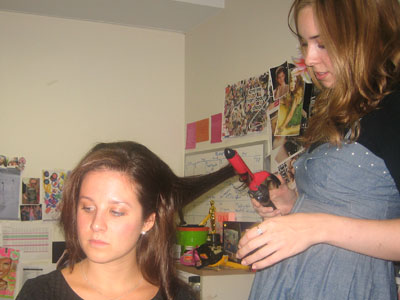 Then, using a curling tong wrap the hair around and hold for smooth curls.
