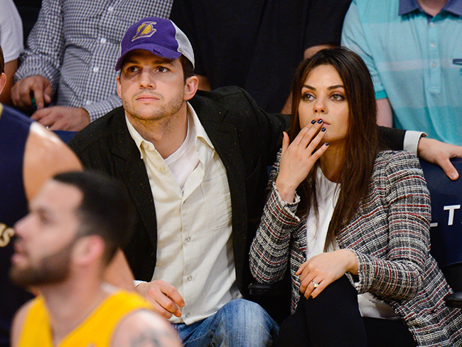Mila Kunis shows off her engagement ring