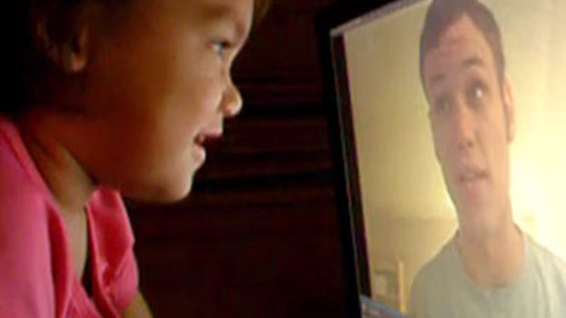 Father reads bedtime stories via video