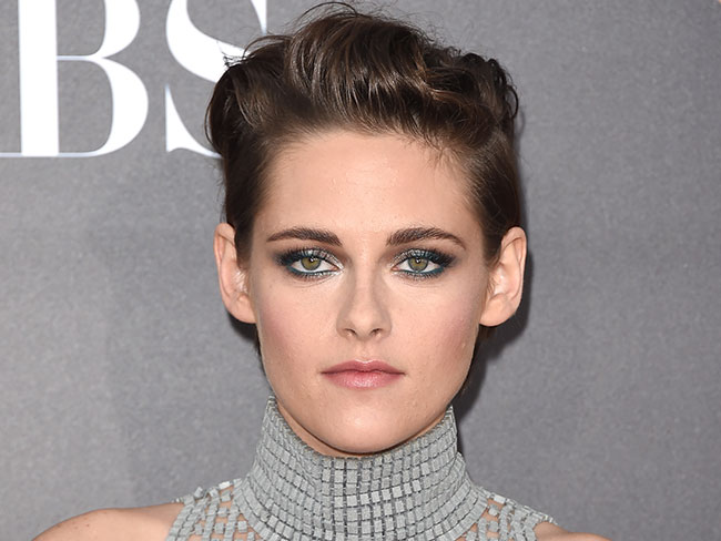 Kristen Stewart's coping just fine with Robert Pattinson's engagement