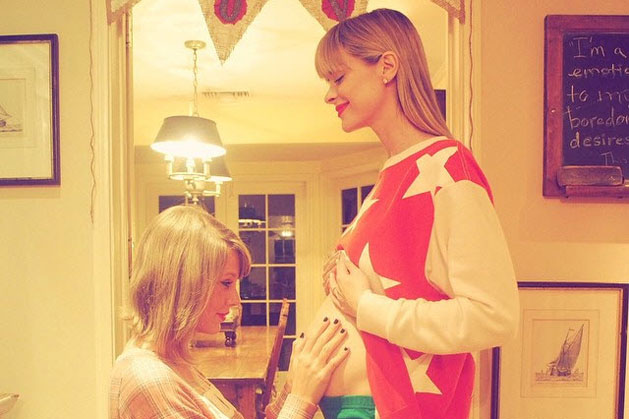 Taylor Swift meets godson for the first time