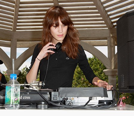 Alexa Chung showing off her DJ skills at the Lacoste party.