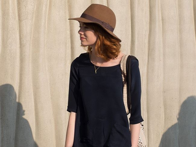 Emma welcomes summer in a brown boho hat and a sweet black summer dress.