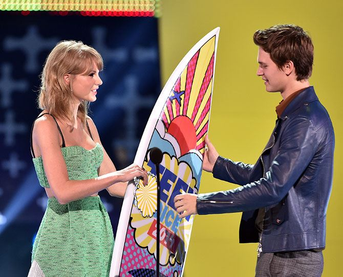 """Taylor Swift presented the award for Choice Movie Actor: Drama and was pretty damn hilarious! """"I was excited when they asked me to come and present this award because nobody knows more about dramatic males than I do,"""" she joked. In the end Ansel Elgort won for his role in *The Fault In Our Stars*. His acceptance speech also gets a heart-warming tick: """"My heart goes out to everyone who's dealing with [cancer] because cancer sucks,"""" he said."""