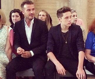 David and Brooklyn Beckham sit front row at VB's show