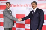 Mahindra executives Mr Anand Mahindra and Mr S.P Shukla unveiling the business' new visual identity