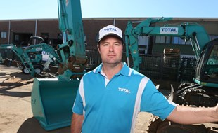 Total Dry Hire Director Mat Poole with his Kobelco excavators.