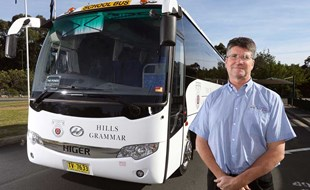 Stephen Trlin, of Norwest Coaches, proudly stands by his Higer Midi Boss which he uses to service private schools